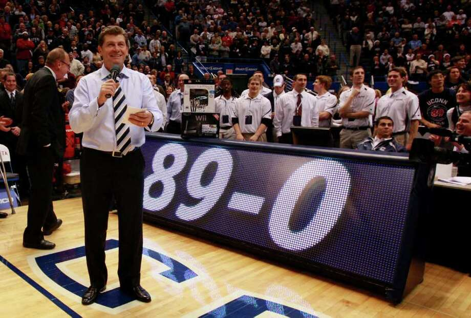 HARTFORD, CT - DECEMBER 21:  Coach Geno Auriemma of Connecticut celebrates a win over  Florida State on December 21, 2010 in Hartford, Connecticut.  Connecticut set a record with 89 straight wins without a defeat. (Photo by Jim Rogash/Getty Images) *** Local Caption *** Geno Auriemma Photo: Jim Rogash, Getty Images / 2010 Getty Images