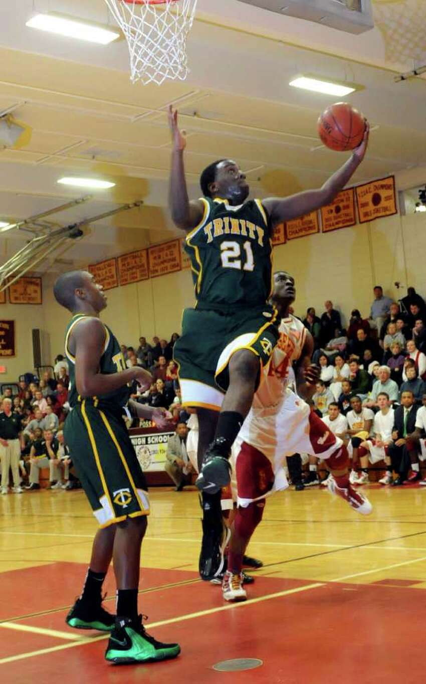 Trinity Catholic's Aaron Spence puts up a shot during Tuesday's game between Trinity and St. Joseph in Trumbull on December 21, 2010.