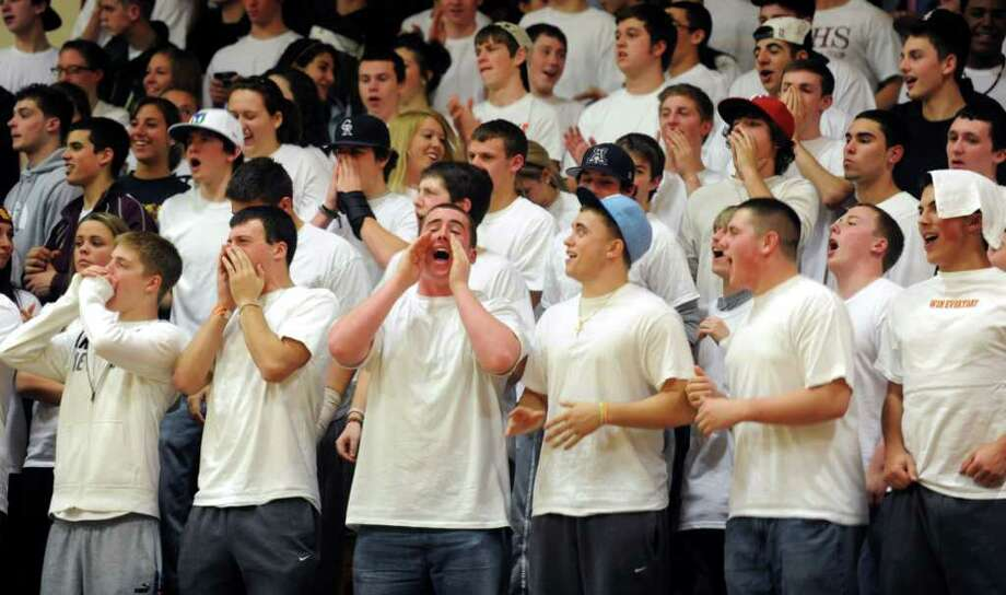 St. Joseph students cheer for their team during Tuesday's game between Trinity and St. Joseph in Trumbull on December 21, 2010. Photo: Lindsay Niegelberg / Connecticut Post