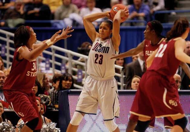 HARTFORD, CT - DECEMBER 21:  Maya Moore #23 of the Connecticut feels the pressure of Chelsea Davis #34 of the Florida St. on December 21, 2010 in Hartford, Connecticut.  Connecticut set a record with 89 straight wins without a defeat. (Photo by Jim Rogash/Getty Images) *** Local Caption *** Maya Moore;Chelsea Davis Photo: Jim Rogash, Getty Images / 2010 Getty Images
