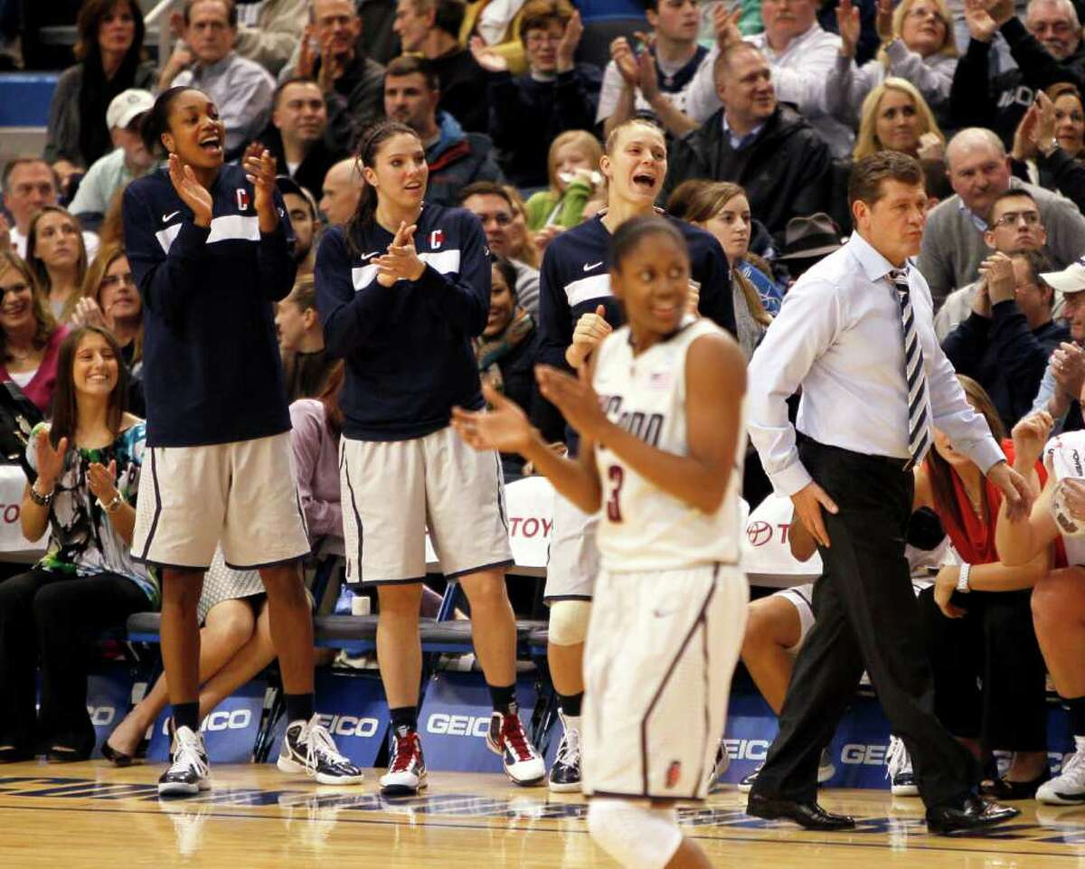 HARTFORD, CT - DECEMBER 21: Coach Geno Auriemma of Connecticut and the bench react in the first half against Florida State on December 21, 2010 in Hartford, Connecticut. (Photo by Jim Rogash/Getty Images) *** Local Caption *** Geno Auriemma