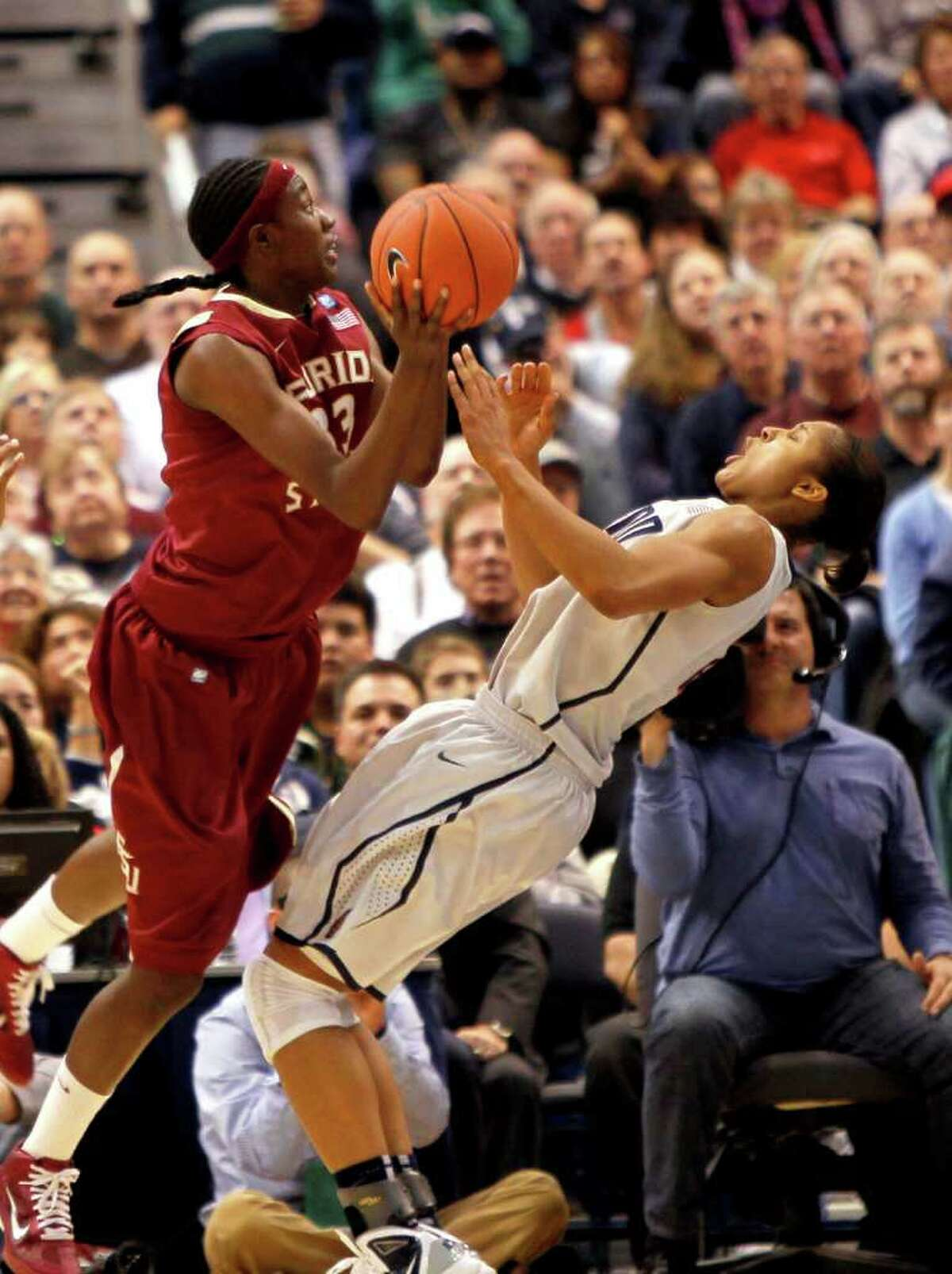 HARTFORD, CT - DECEMBER 21: Maya Moore #23 of the Connecticut is fouled by Natasha Howard #33 of the Florida State during the second half on December 21, 2010 in Hartford, Connecticut. (Photo by Jim Rogash/Getty Images) *** Local Caption *** Maya Moore;Natasha Howard