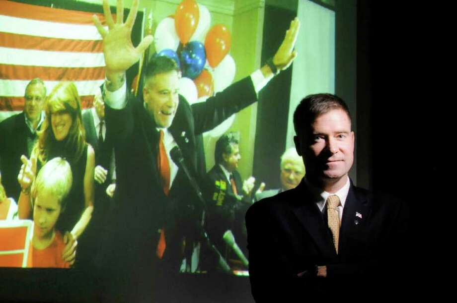 Congressman-elect Chris Gibson stands in front of a projection of a photo from his Election Day victory night. Far behind in early polls, the Republican won by 10 percentage points in the 10-county 20th Congressonal District. ( Michael P. Farrell/Times Union ) Photo: Michael P. Farrell