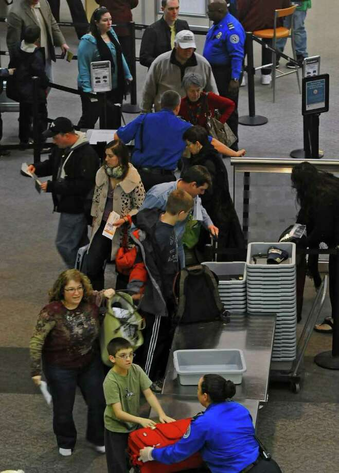 Departing passengers make their way through security in the terminal of the Albany International Airport in Colonie, NY on Tuesday December 21, 2010. ( Philip Kamrass / Times Union ) Photo: Philip Kamrass