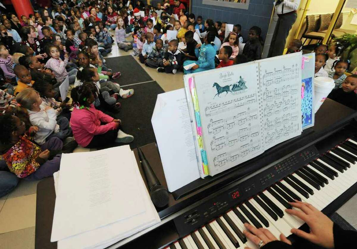The student body gathers for the sounds of the season lead by music teacher Lynette McGovern in the lobby at the Sheridan Prep Elementary School in Albany during a Holiday Songfest December 21, 2010. (Skip Dickstein / Times Union)