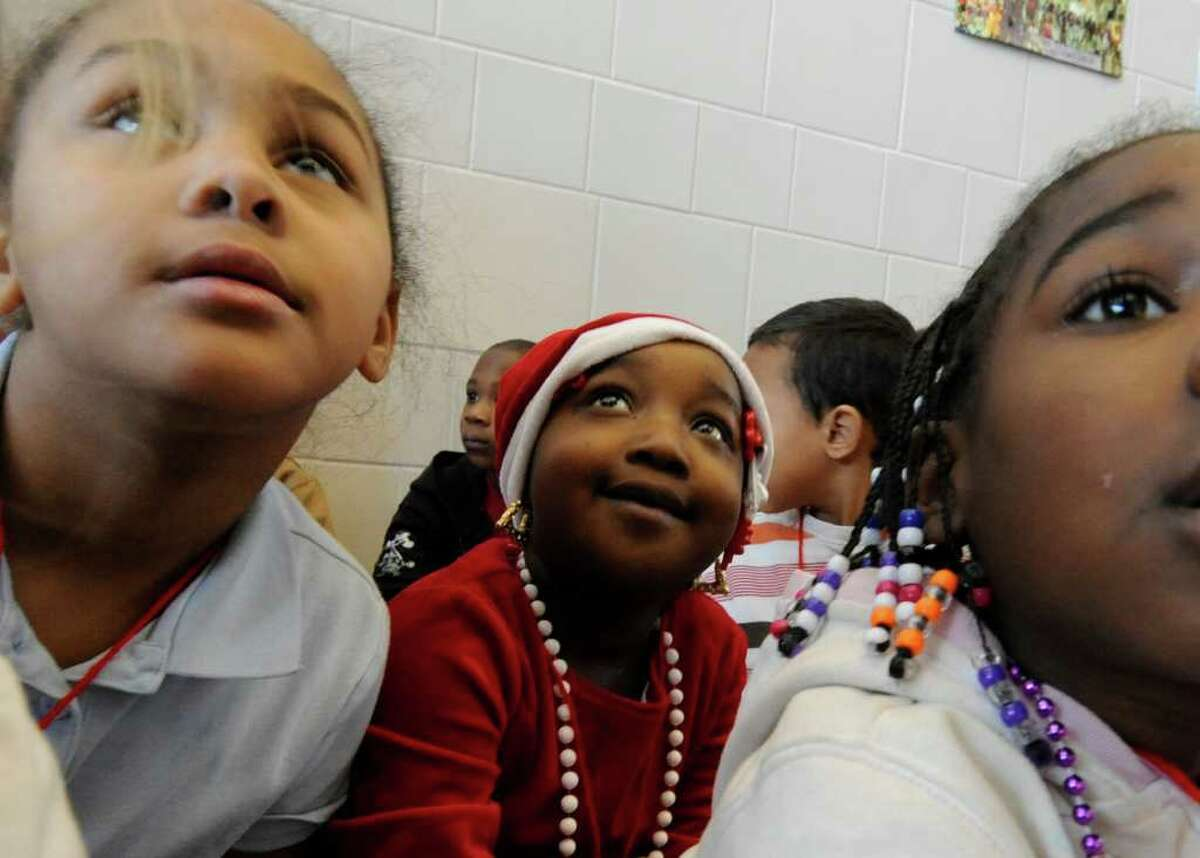 Keytara Jones is all dressed for the season at the Sheridan Prep Elementary School in Albany during a Holiday Songfest December 21, 2010. (Skip Dickstein / Times Union)