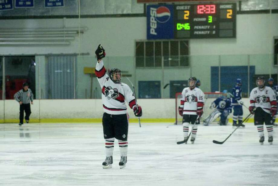New Canaan's David Russell reacts to his goal as New Canaan and Darien High School boys hockey teams face off in Darien, Conn., Monday, December 20, 2010. Photo: Keelin Daly / Stamford Advocate