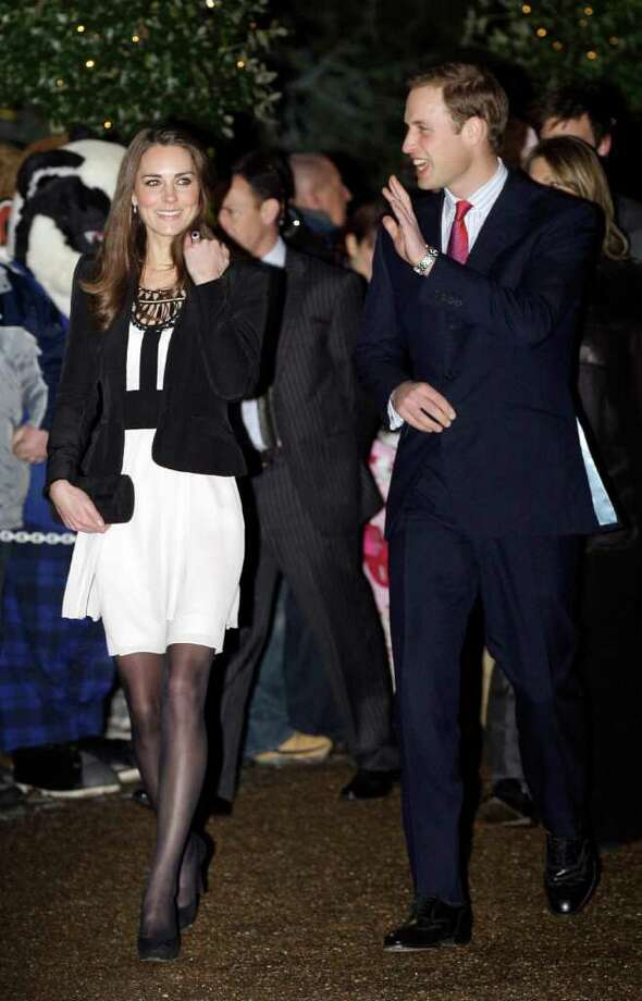 Britain's Prince William and his fiancee Kate Middleton arrive to view the Thursford Christmas Spectacular gala in Thursford, England, Saturday, Dec. 18, 2010.  The royal couple, who are due to marry on April 29, 2011, met young cancer patients and visited the unique fund-raising gala Saturday, which showcases a cast of over 130 professional singers, dancers and musicians.  (AP Photo/Sang Tan) Photo: Sang Tan, STR / AP