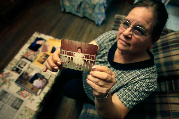 Maria Vasquez, mother of Anna Vasquez, holds her favorite photo of her daughter, Anna Vasquez, in 2010.