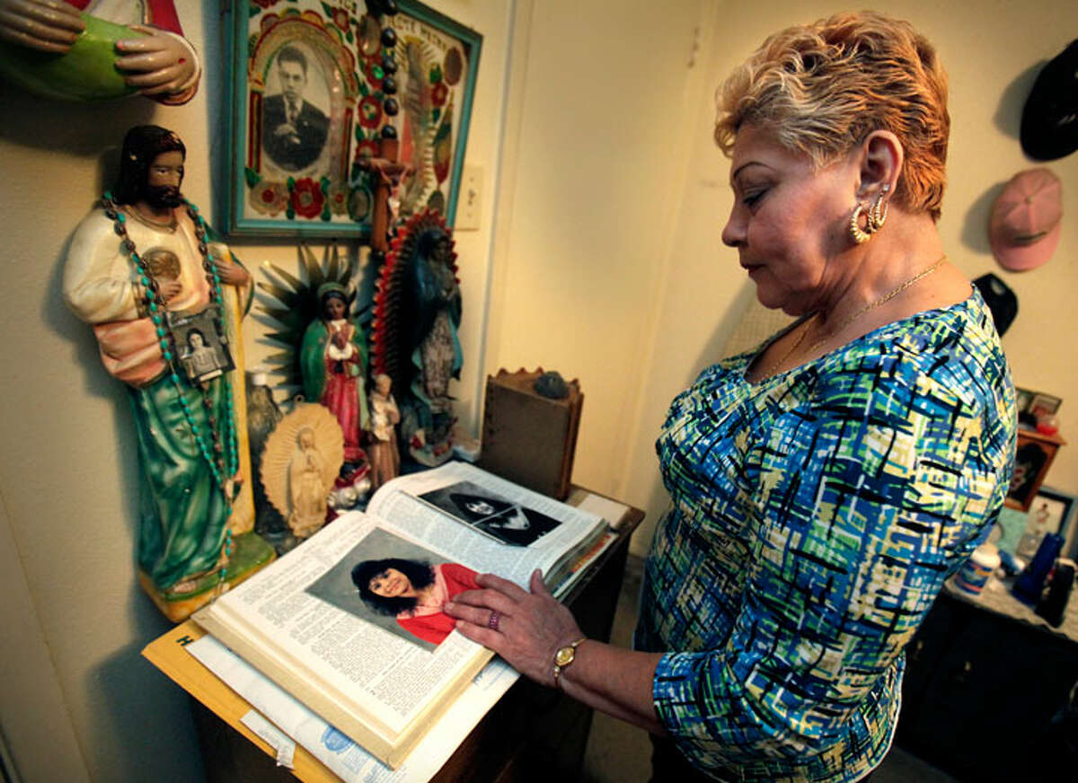 Gloria Herrera keeps a picture of imprisoned daughter Elizabeth Ramirez in a Bible in her bedroom. The young accusers were staying with Ramirez. BOB OWEN/rowen@express-news.net