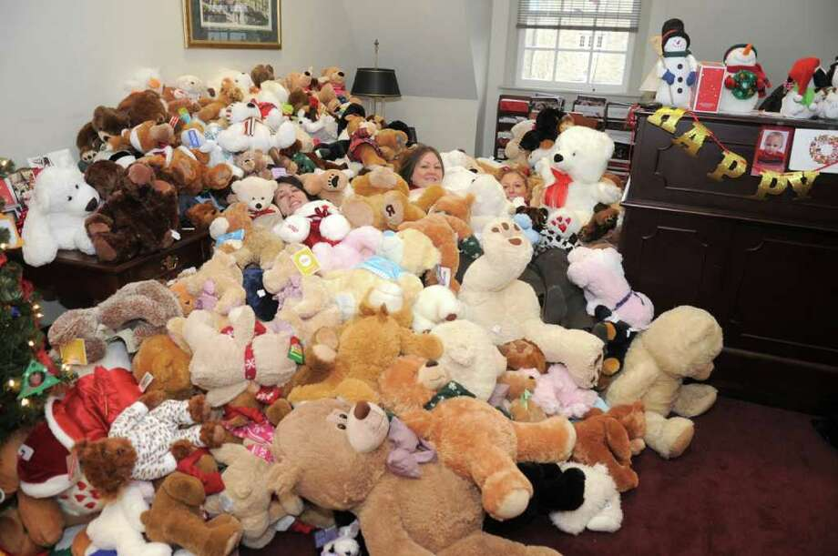 Alumni House  Alumni Relations sponsors Teddy Bears for Love.  From left, Colleen McGinn , Maria Bolis and Jessica Viner are surrounded by Teddy Bears to give to area hospitals, collected through a volunteer effort by student alumni at Fairfield University. Photo: Jean Santopatre;Contributed Photo, Contributed Photo / Fairfield Citizen