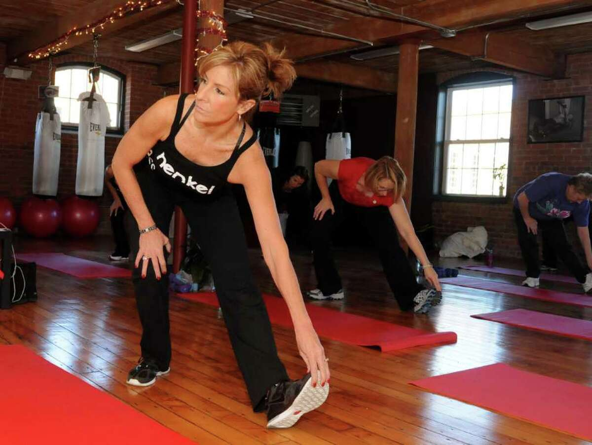 Kathy Henkel, owner of Kathy Henkel Fitness in New Milford, instructs her Power Hour class on Wed. Dec. 22, 2010.