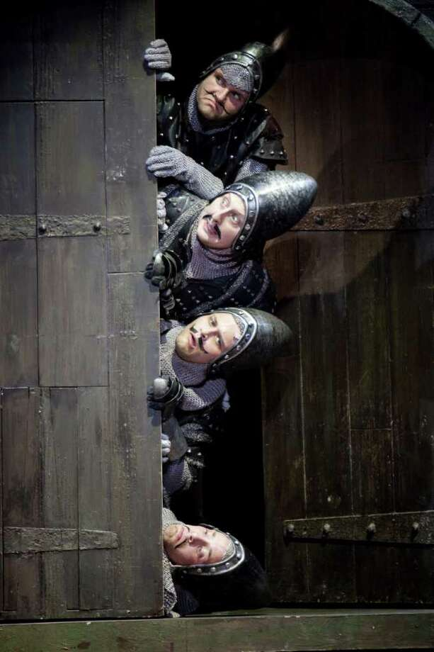"""The French Taunters"" go into their act in ""Spamalot"" - from top to bottom, Carl Draper, Thomas DeMarcus, Adam Grabau ad Michael Warrell - the hit musical derived from the cult film, ""Monty Python and the Holy Grail."" Grabau also plays Prince Lancelot in the show. Photo: Contributed Photo / Connecticut Post Contributed"