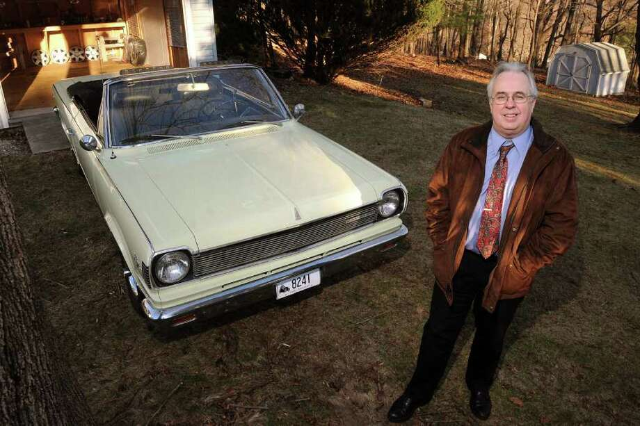 Patrick Foster has written 13 books about old cars, and his Hudson book is the most recent. Foster poses in the back yard with his restored 1967 Rambler Rogue in Milford, Conn. on Wedensday December 22, 2010. Photo: Christian Abraham / Connecticut Post