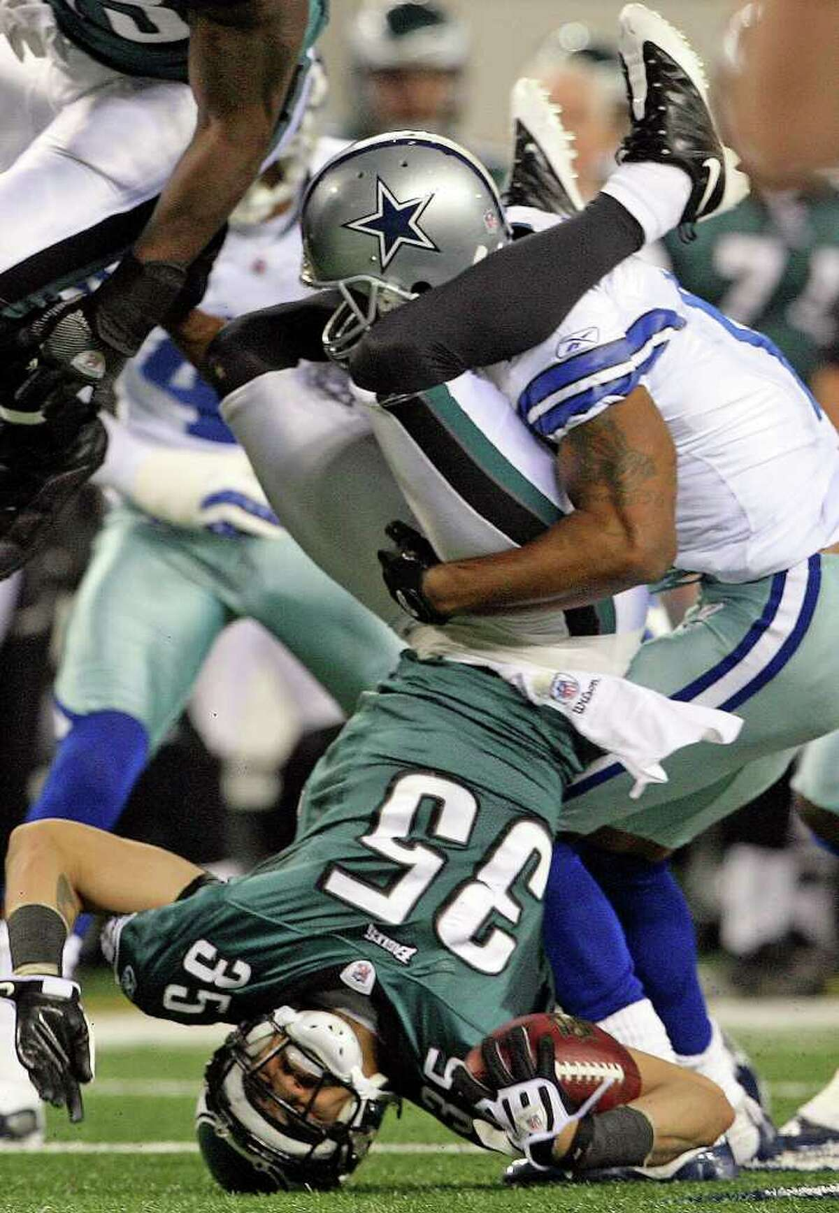 SPORTS Eagles return specialist Macho Harris gets upended on a kickoff return as the Dallas Cowboys play the Philadelphia Eagles in first round NFL playoff action at Dallas on January 9, 2010. Tom Reel/Staff