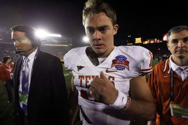 Colt McCoy leaves the field after his Longhorns lost the national Championship game in the Rose Bowl 37-21 Thursday, January 7, 2009. during the third quarter of the Citi BCS National Championship football game at the Rose Bowl on Thursday, Jan. 7, 2010, in Pasadena, Calif. Photo: TOM REEL, Tom Reel/Express-News / © 2010 San Antonio Express-News
