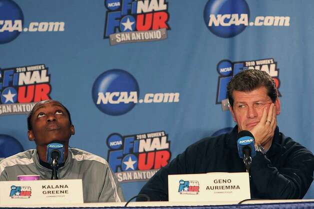 University of Connecticut Kalana Greene and head coach Geno Auriemma wait their turn during team interviews at the Alamodome, Monday, April 5, 2010. Photo: JERRY LARA, SAN ANTONIO EXPRESS-NEWS / glara@express-news.net