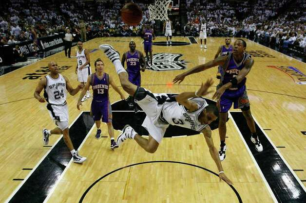 San Antonio Spurs George Hill is fouled by Phoenix Suns Channing Frye in the first half of game 3 of seven series in the Western Conference Semifinals at the AT&T Center, Friday, May 7, 2010. Photo: JERRY LARA, SAN ANTONIO EXPRESS-NEWS / glara@express-news.net
