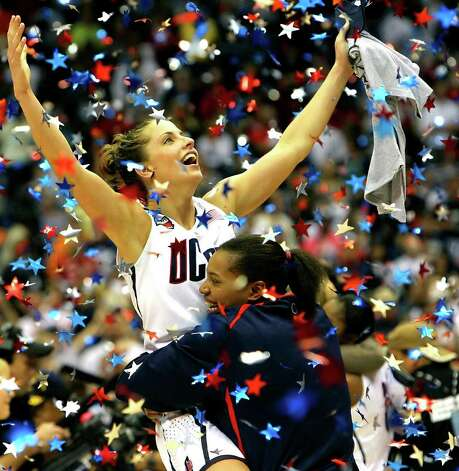 The Connecticut Huskies' Caroline Doty celebrates Tuesday night April 6, 2010 at the Alamodome in San Antonio, Texas after the Huskies won their second straight NCAA Women's Final Four Championship after beating Stanford.  Connecticut won 53-47 in the first back-to-back undefeated championship seasons in the history of NCAA women's basketball. Photo: Jerry Lara, SAN ANTONIO EXPRESS-NEWS / glara@express-news.net