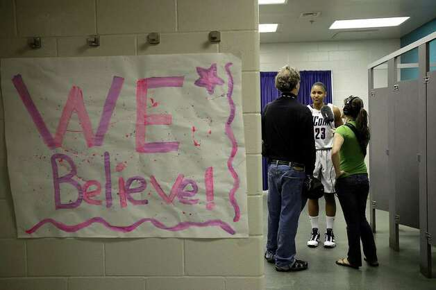 University of Connecticut forward Maya Moore is interviews in the restrooms of their locker room by Sports Illustrated at the Alamodome, Monday, April 5, 2010. Photo: JERRY LARA, SAN ANTONIO EXPRESS-NEWS / glara@express-news.net