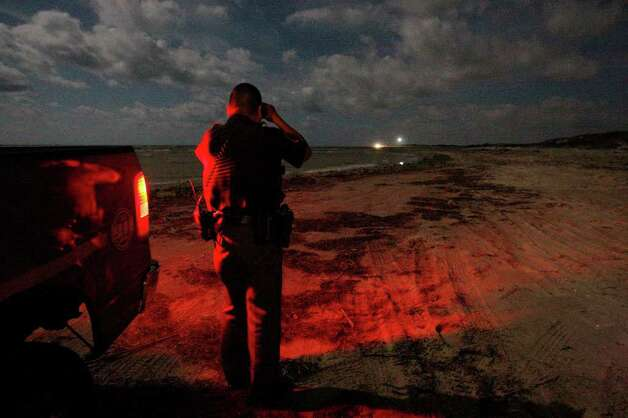 Cameron County Sheriff's Lt. Robert Rodriguez spots headlights on the Mexican side of the Rio Grande as he patrols Boca Chica Beach, Thursday, Oct. 22, 2010. He called for backup from the Border Patrol agents, who are equipped with night vision scopes. After their arrival, they were able to ascertain that the men on the Mexican side were fishing the mouth of the river by Playa Baghdad. Photo: JERRY LARA, SAN ANTONIO EXPRESS-NEWS / glara@express-news.net