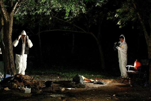 Members of a Nuevo Leon Forensic unit document the scene of a confrontation between the Mexican army and alleged kidnappers at a ranch just west of Ceralvo, Mexico, Wednesday, Sept. 29, 2010. The army responded to a call of men holding kidnap victims at the ranch and a gunfight broke out when they arrived. Four of the kidnappers were killed and four of the victims were rescued. According to Gen. Cuauhtemoc Antunes, the victims were laborers from the Ceralvo area. Photo: JERRY LARA, SAN ANTONIO EXPRESS-NEWS / glara@express-news.net