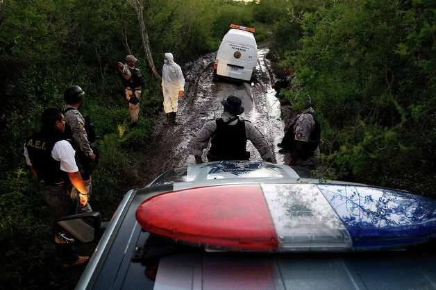 A Nuevo Leon Forensic unit van gets stuck in mud as they while attempting to reach the scene of a confrontation between the Mexican army and alleged kidnappers at a ranch just west of Ceralvo, Mexico, Wednesday, Sept. 29, 2010. The army responded to a call of men holding kidnap victims at the ranch and a gunfight broke out when they arrived. Four of the kidnappers were killed and four of the victims were rescued. According to Gen. Cuauhtemoc Antunes, the victims were laborers from the Ceralvo area. Photo: JERRY LARA, SAN ANTONIO EXPRESS-NEWS / glara@express-news.net