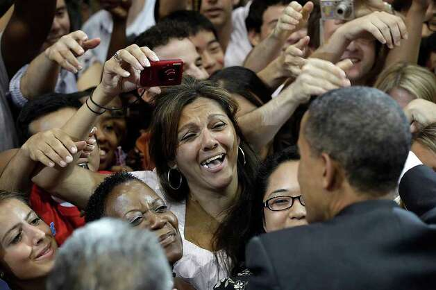 President Barack Obama greets students and supporters after his speech at Gregory Gym of the University of Texas in Austin, Monday, Aug. 9, 2010. Photo: JERRY LARA, SAN ANTONIO EXPRESS-NEWS / glara@express-news.net