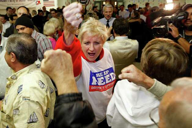 Bexar County District Attorney Susan Reed raises her fist in victory with supporters as she arrives at the Bexar County Republican headquarters at the corner of Broadway and Ninth, Tuesday, Nov. 2, 2010. Photo: JERRY LARA, SAN ANTONIO EXPRESS-NEWS / glara@express-news.net