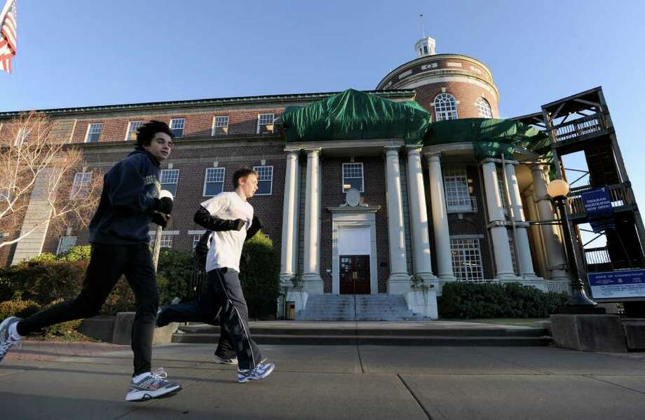 Runners jog past the YMCA of Greenwich, 50 East Putnam Ave., Tuesday, Dec. 21, 2010. Photo: Bob Luckey / Greenwich Time