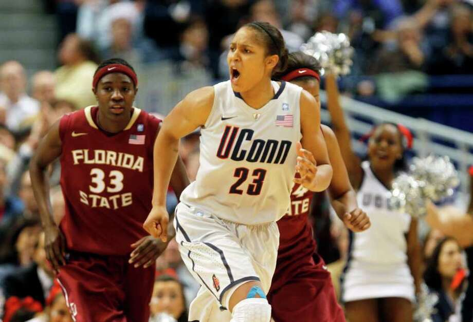 HARTFORD, CT - DECEMBER 21:  Maya Moore #23 of the Connecticut reacts in the final minutes of a win over Florida State on December 21, 2010 in Hartford, Connecticut.  Connecticut set a record with 89 straight wins without a defeat. (Photo by Jim Rogash/Getty Images) *** Local Caption *** Maya Moore Photo: Jim Rogash, Getty Images / 2010 Getty Images