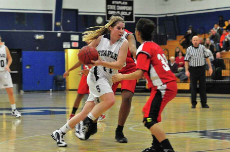 Staples senior captain Nikki Brill lays it in for two of her 13 points on Tuesday in a 78-38 victory over Bridgeport Central. Brill also had 15 rebounds and seven assists. Photo: Contributed Photo / Tom Werner