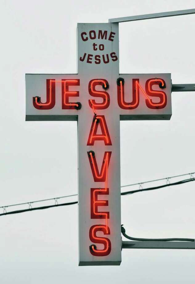 """Jesus aves"" sign outside Capital City Rescue Mission in Albany Wednesday afternoon December 22, 2010.  (John Carl D'Annibale / Times Union) Photo: John Carl D'Annibale / 00011501A"