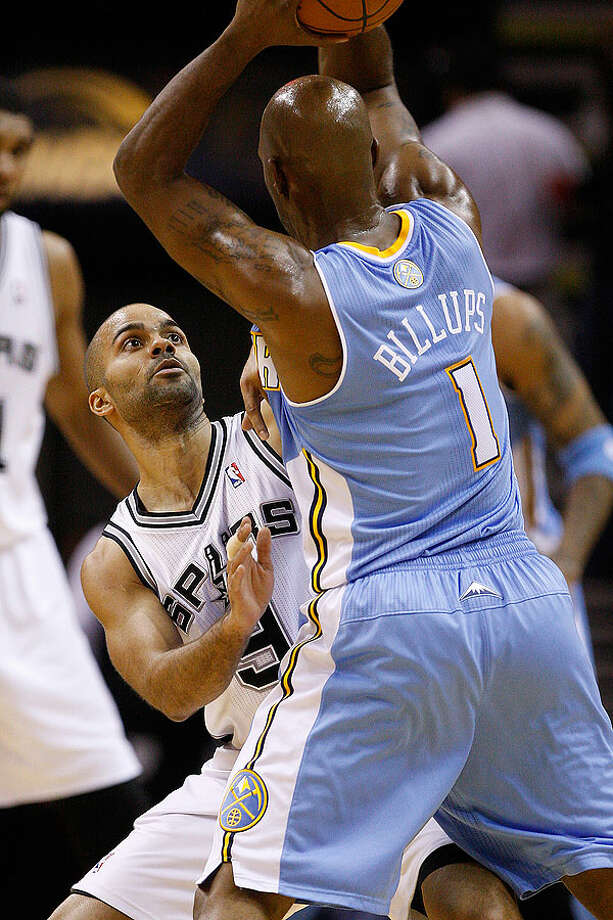 The Spurs' Tony Parker puts pressure on the Nuggets' Chauncy Billups during the first half at the AT&T Center, Wednesday. Photo: JERRY LARA/glara@express-news.net