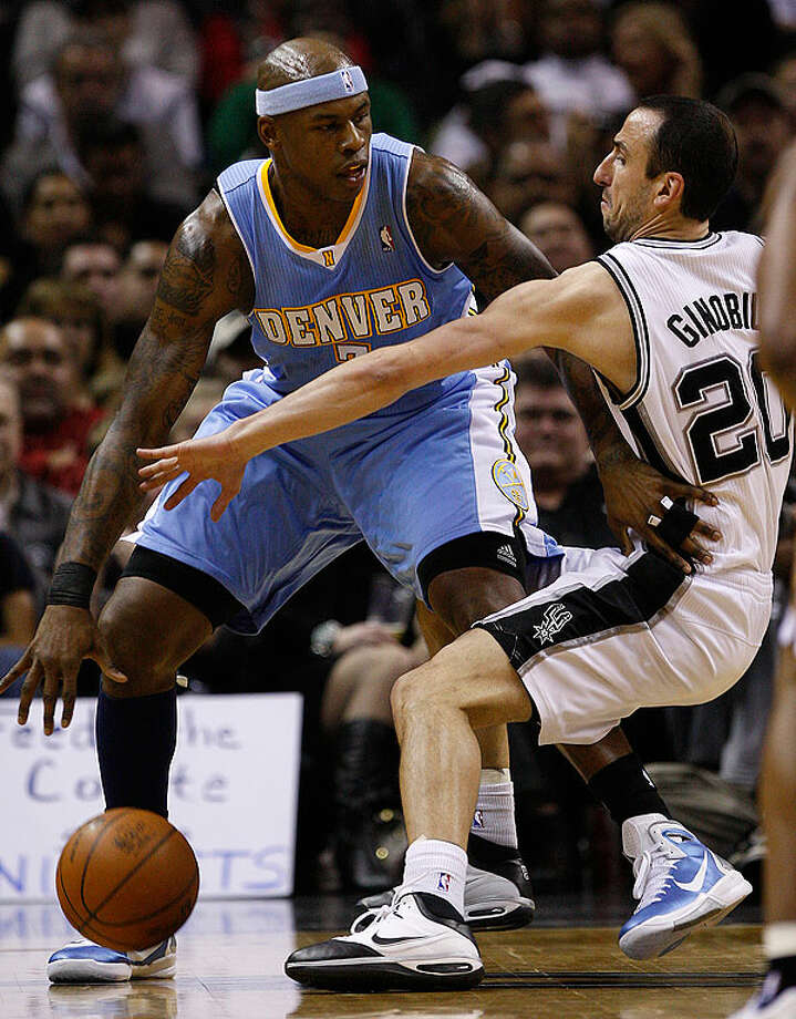 The Spurs' Manu Ginobili puts pressure on the Nuggets' Al Harrington during the second half at the AT&T Center, Wednesday. The Spurs won 109-103.