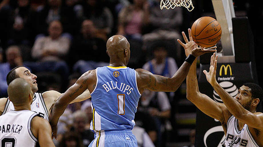 The Nuggets' Chauncey Billups splits the defense of the Spurs' Tony Parker (from left), Manu Ginobili and Tim Duncan during the first half at the AT&T Center, Wednesday. The Spur went on to win 109-103. Photo: JERRY LARA/glara@express-news.net