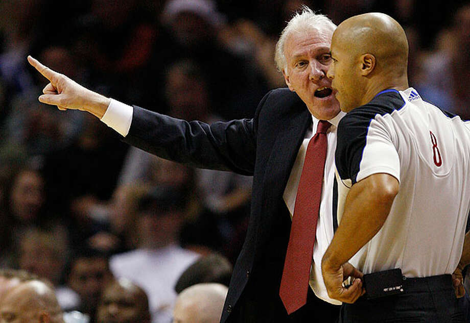 Spurs coach Gregg Popovich gets in the face of Marc Davis during second half against the Denver Nuggets at the AT&T Center, Wednesday. The Spurs won 109-103. Photo: JERRY LARA/glara@express-news.net