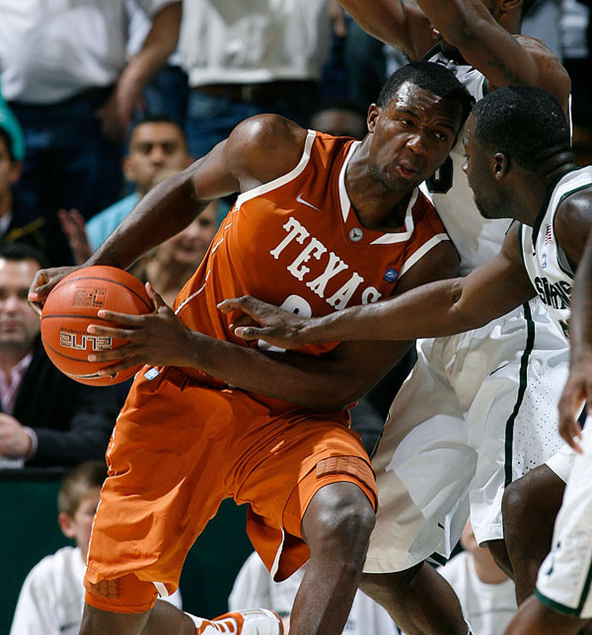 Texas' Jordan Hamilton (left) drives against Michigan State's Draymond Green on Wednesday in East Lansing, Mich. Hamilton led Texas with 21 points in a 67-55 win.