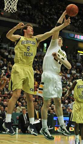 From right, Siena's Ryan Rossiter battles with Georgia Tech's Daniel Miller for a rebound during a basketball game at the Times Union Center in Albany, NY on December 22, 2010.  (Lori Van Buren / Times Union) Photo: Lori Van Buren