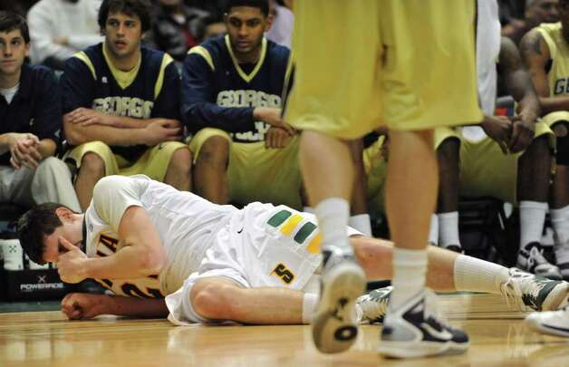 Siena's Ryan Rossiter falls to the ground after being jabbed in the eye during a game against Georgia Tech at the Times Union Center in Albany, NY on December 22, 2010.  (Lori Van Buren / Times Union) Photo: Lori Van Buren