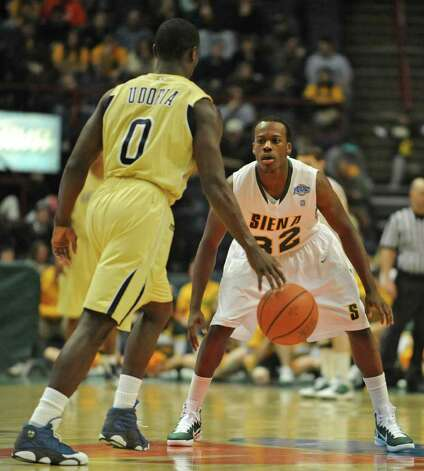 Siena's Jonathan Breeden defends Georgia Tech's Mfon Udofia during a basketball game at the Times Union Center in Albany, NY on December 22, 2010.  (Lori Van Buren / Times Union) Photo: Lori Van Buren