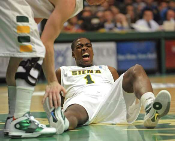 Siena's OD Anosike gets a cramp during a game against Georgia Tech at the Times Union Center in Albany, NY on December 22, 2010.  (Lori Van Buren / Times Union) Photo: Lori Van Buren