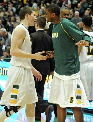 Siena's Kyle Downey gets a shake from teammate Clarence Jackson after winning a game against Georgia Tech at the Times Union Center in Albany, NY on December 22, 2010.  (Lori Van Buren / Times Union) Photo: Lori Van Buren