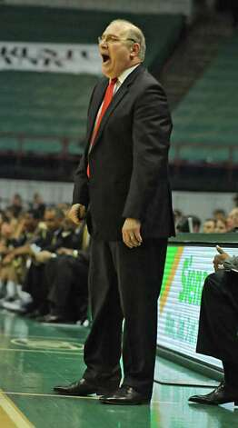 Siena's head coach Mitch Buonaguro yells during a game against Georgia Tech at the Times Union Center in Albany, NY on December 22, 2010.  (Lori Van Buren / Times  Union) Photo: Lori Van Buren