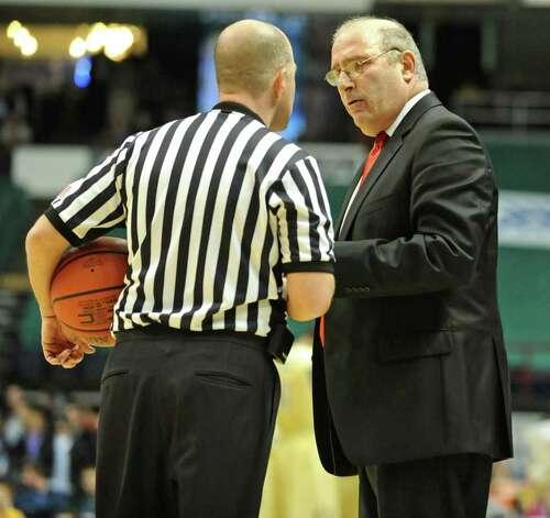 Siena's head coach Mitch Buonaguro talks to a referee during a game against Georgia Tech at the Times Union Center in Albany, NY on December 22, 2010.  (Lori Van Buren / Times Union) Photo: Lori Van Buren