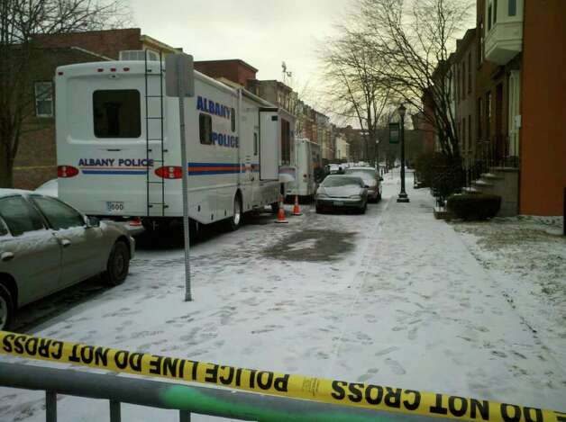 The scene Thursday morning near the Westerlo Street home in Albany where police said a man is holding at least one person hostage. (Dayelin Roman / Times Union)