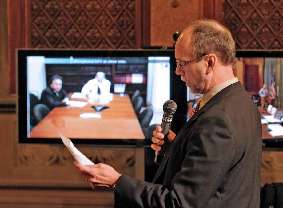 NYSTI Producing Director David Bunce fails to save the Troy-based theater troupe despite an impassioned plea Wednesday before the board.  On the video screen on the left is a live feed from New York City, where board chairman Larry Schwartz is located for the session.    (Skip Dickstein / Times Union) Photo: Skip Dickstein