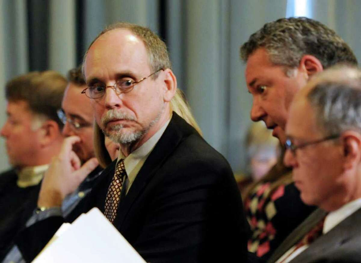 NYSTI Interim Director David Bunce, left. listens to his attorney Lawrence Schillinger after failing save the theatre group during a board meeting held at the Capitol in Albany December 22, 2010. (Skip Dickstein / Times Union)