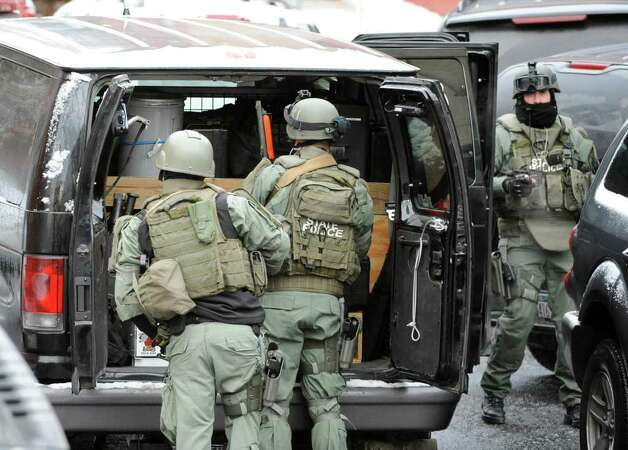 New York State Police Special Operations members arrive at the scene of a hostage situation on Westerlo Street in Albany on December 23, 2010.    (Skip Dickstein / Times Union) Photo: SKIP DICKSTEIN