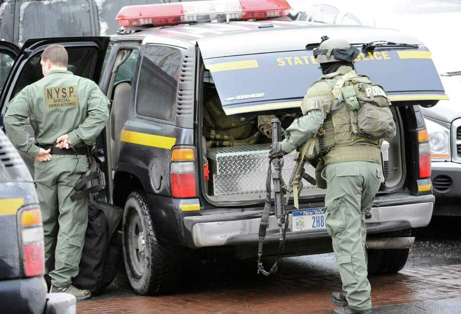 The State Police SWAT team arrives at the scene of a hostage situation Thursday morning on Westerlo Street in Albany. (Skip Dickstein / Times Union) Photo: SKIP DICKSTEIN